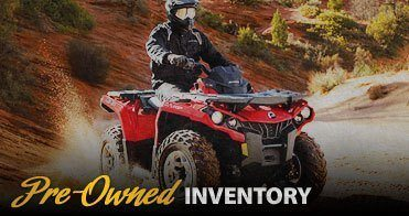 Pre-Owned Inventory button's background image of a Can-Am ATV in action